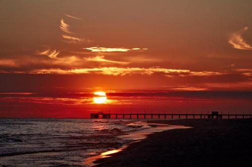Sunset over the Gulf State Park Pier